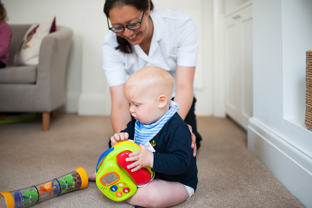 Hove Cranial Osteopath Aimee Cox treating baby